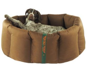 A brown Durasoft nest with a German Wirehaired Pointer.