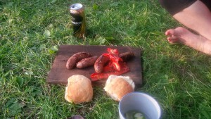 Picture of sausages and bread on wood plate