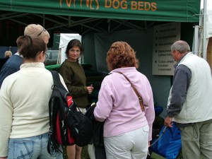 Luise talking to customers in game fair stand