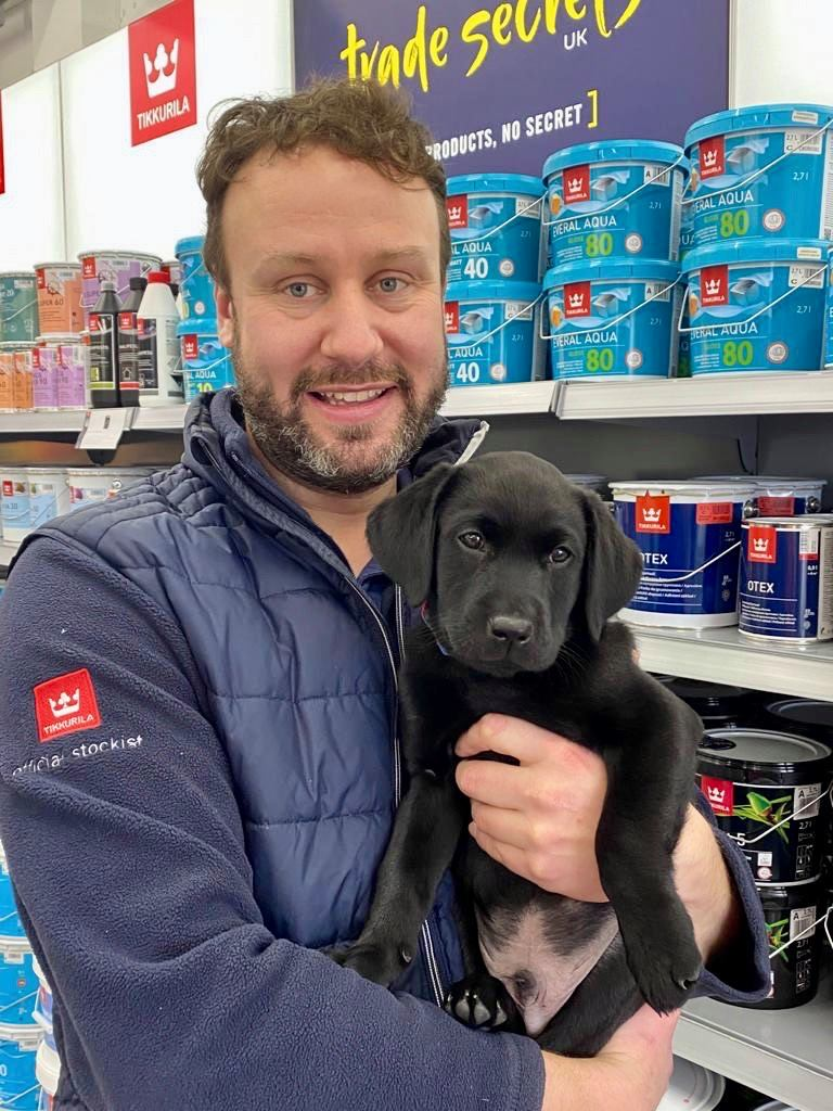 Scott and his new puppy, Dexter, in front of Paint Tubs at Trade Secrets